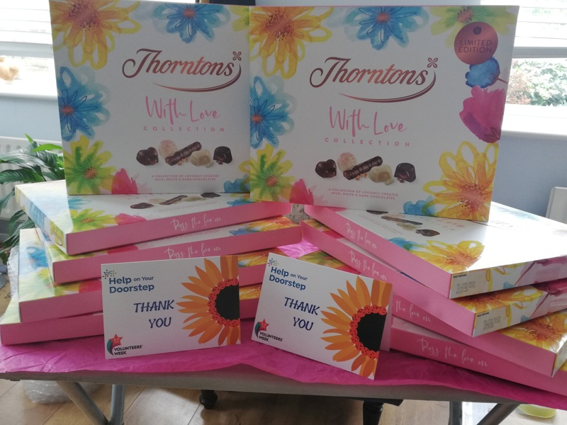 A photo of chocolates and thank you cards sent to our volunteers.