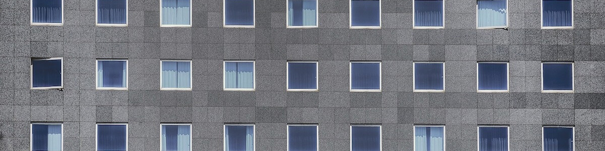 Windows in a tower block. Image by coombesy from Pixabay