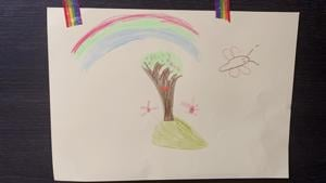 A childs drawing of a rainbow with a tree underneath it.